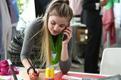 Fashion Clothes To Bespoke Designer Talking Phone. Busy Young Woman With Smartphone. Caucasian Seams poster