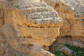 stock photo of jericho  - Scenic stratified orange rock on the cliff - JPG