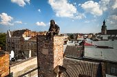 LVIV, UKRAINE - AUG 6: Chimneysweep monument is on the roof of a historic building House of Legends