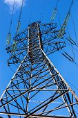 foto of electricity pylon  - High voltage electricity pylon against blue sky - JPG