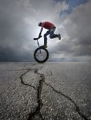 pic of unicycle  - Young man unicycle on the street - JPG
