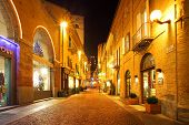 ALBA - DECEMBER 07: Popular touristic street in old city historic center with opened shops, bars and