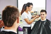 picture of beauty parlour  - Female hairdresser cutting hair of smiling man client at beauty parlour - JPG