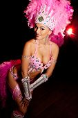 foto of brazilian carnival  - cabaret dancer over dark background - JPG