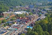 stock photo of gatlinburg  - Downtown Gatlinburg Tennessee viewed from above looking away from Smoky Mountains National Park - JPG