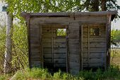 stock photo of outhouse  - Old Alaskan double wide outhouse without doors - JPG