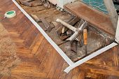 image of chisel  - Old parquet floor remove with chisel hammer tools - JPG