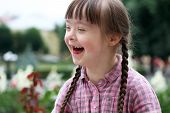 foto of playgroup  - Portrait of beautiful young girl smiling in the garden  - JPG