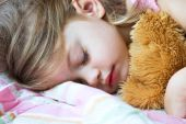 foto of goodnight  - Toddler sleeping with her teddy bear on a pink blanket - JPG