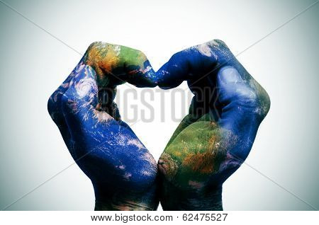 a world map in man hands forming a heart (Earth map furnished by NASA) poster