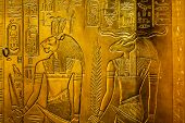 image of hieroglyphic  - Relief in gold with the egypt gods Sekhmet and Chnum - JPG