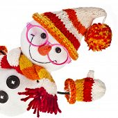 stock photo of knitted cap  - happy snowman spectacled in knitted hat and scarf and mittens isolated on white background - JPG