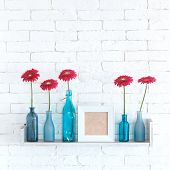 image of vase flowers  - Decorative shelf on white brick wall with flowers in vase on it - JPG