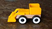 foto of dozer  - Simple wheel dozer toy plastic and wood - JPG