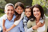 stock photo of four  - Portrait Of Hispanic Family In Countryside - JPG