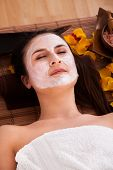 Woman With Face Mask In Spa Centre