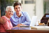 pic of 16 year old  - Teenage Grandson Helping Grandmother With Laptop - JPG