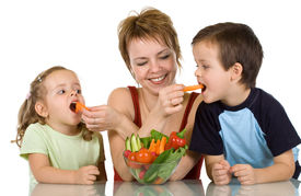 image of healthy eating girl  - Woman feeding kids with fresh vegetables  - JPG
