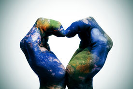 picture of save earth  - a world map in man hands forming a heart  - JPG