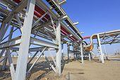 stock photo of oilfield  - Oil field scene oil pipeline under the blue sky - JPG