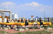 stock photo of nod  - In oil field there is oil pipeline and oilfield equipment at work - JPG