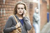 pic of she-male  - Teenage Girl Using Phone As She Feels Intimidated On Walk Home