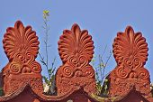 image of neoclassical  - yellow flower on vintage neoclassical roof antefix - JPG