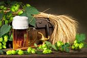 foto of spigot  - glass of beer with raw material for beer production - JPG