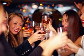 stock photo of bowing  - beautiful women clinking glasses in limousine - JPG
