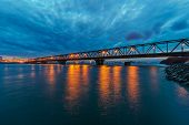 stock photo of serbia  - Bridge across river at night with artificial lightning Belgrade Serbia - JPG