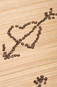 stock photo of siluet  - Siluet hearts damaged boom laid out coffee beans - JPG