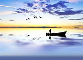stock photo of life-boat  - fisherman on wooden boat on the lake at sunrise - JPG