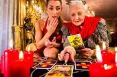 pic of pentagram  - Fortuneteller laying Tarot cards with client on pentagram - JPG