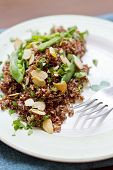 stock photo of quinoa  - Healthy nutty red quinoa salad with sugar snap peas sliced toasted almonds and chopped parsley