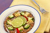 stock photo of tabouleh  - Red Quinoa Tabbouleh salad with juicy grilled chicken and cucumbers with chopped parsley  - JPG