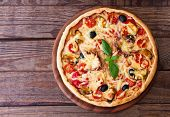 picture of hot fresh pizza  - Delicious fresh pizza with seafood on wood table horizontal - JPG