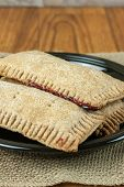 image of fill  - Whole wheat toaster pastries lightly dusted with sugar crystals and filled with raspberry filling - JPG