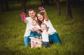 foto of nesting box  - Happy family with nesting box and colorful paints in green summer forest - JPG