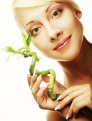 stock photo of greenpeace  - young beautiful woman with bamboo - JPG