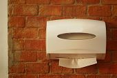 stock photo of tissue box  - Tissue box on a background of a brick - JPG