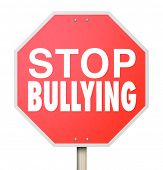 picture of stop bully  - Stop Bulling words on a red road or street sign to prevent children from picking on - JPG