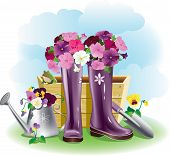 pic of beside  - Flowers petuni in gumboots beside garden tools - JPG