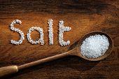 image of sea salt  - Sea salt on wooden spoon and the word salt written in grain - JPG