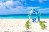 stock photo of wedding arch  - beautiful decorated wedding arch on sand beach - JPG