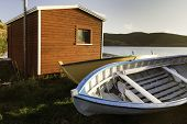 foto of dory  - Newfoundland boats from a small rural fishing community under a golden sunset sky - JPG
