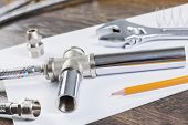pic of plumbing  - All kinds of plumbing and tools on white paper - JPG
