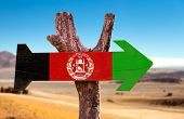 stock photo of civil war flags  - Afghanistan Flag wooden sign with desert background - JPG