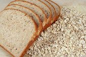 picture of whole-grain  - slices of bread layed out on oats - JPG