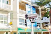 foto of cctv  - Close up CCTV security camera in front of the vinlage