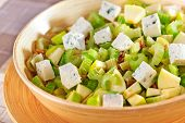 stock photo of celery  - Salad with celery apple and blue cheese in large salad bowl ready to be served - JPG